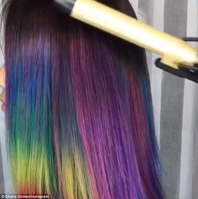 From purple to pink: Taylor Rae , who is a Pravana Vivids specialist in Denver, Colorado, ran a hot curling iron over a client